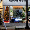 JOED VIERA/STAFF PHOTOGRAPHER-Lockport, NY- George Fritz designs jewlery on a computer behind Mill's Jewelers decorated window.