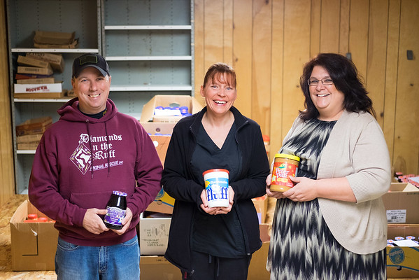 JOED VIERA/STAFF PHOTOGRAPHER-Lockport , NY-Kenny allore, Cheryl Yurek and Tracy Williams hold donations for the Annual Peanut Butter and Jelly Drive in the basement of the Second Presbyterian Church on Van Buren St.