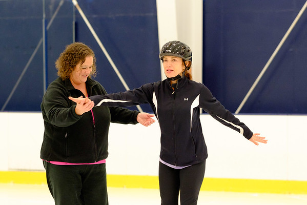 JOED VIERA/STAFF PHOTOGRAPHER-Lockport , NY-Dawn Ahlers helps Allison Barto with her form.