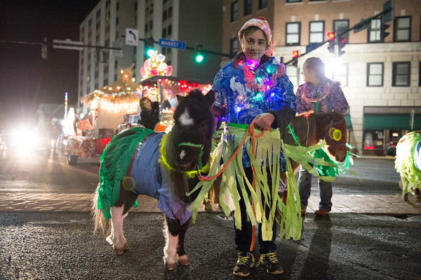 JOED VIERA/STAFF PHOTOGRAPHER-Lockport, NY-    A Miniature horse and its handler walk in the Light Up Lockport Parade.