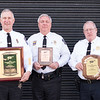 JOED VIERA/STAFF PHOTOGRAPHER-Lockport, NY-  MIddleport, Barker and Lockport Police Chiefs John Swick, W. Ross Annable and Michael Niethe hold up their department's AAA Community Traffic Safety Awards .