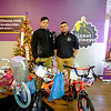 JOED VIERA/STAFF PHOTOGRAPHER-Lockport, NY- Planet Fitness employees Jordan Bugna and Michael Ferguson stand by the Lockport Angel Tree.