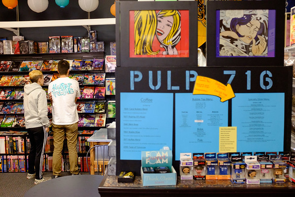 JOED VIERA/STAFF PHOTOGRAPHER-Lockport , NY-Esme Kenyon, 18, and Bailey Simone, 19, browse the comic book selection at Pulp 716.