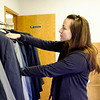 JOED VIERA/STAFF PHOTOGRAPHER-Lockport, NY-One stop Veterans Center operations manager Erika Veltri sorts through donated suits for Veterans in need.