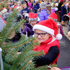 JOED VIERA/STAFF PHOTOGRAPHER-Gasport, NY-Roy-Hart 4th-grader Ali Ausman, 9, places a gift request written on a mitten on the Christmas tree in front of the Gasport Post Office.