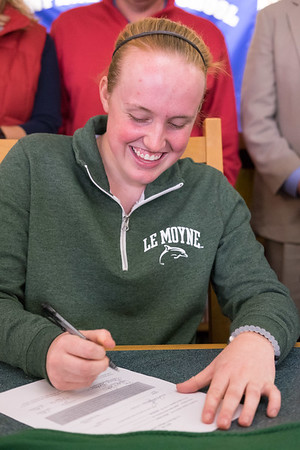 JOED VIERA/STAFF PHOTOGRAPHER-Newfane, NY-Olivia Littman, 17, signs her   letter of intent to play D2 Softball at LeMoyne College.