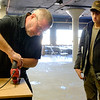 JOED VIERA/STAFF PHOTOGRAPHER- Lockport, NY-Paul Crawford, left, shows the Jesse Wilcox how to use a jigsaw at Isaiah 61.