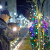JOED VIERA/STAFF PHOTOGRAPHER- Lockport, NY-Bill Kinney, Mary Schnieder and Chris Parada decorate the trees on the Main Street medians with christmas lights.
