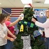 JOED VIERA/STAFF PHOTOGRAPHER-Lockport, NY-   Lisa Weaver-Sidor, Jennifer Podgorny and Sandy Wheeler decorate the giving tree at the Lockport Department of Motor Vehicles.