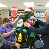 JOED VIERA/STAFF PHOTOGRAPHER-Lockport, NY-   Sandy Wheeler, Jennifer Podgorny and County Clerk Joseph A. Jastrzemski decorate the giving tree at the Lockport Department of Motor Vehicles.