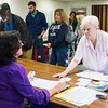 JOED VIERA/STAFF PHOTOGRAPHER-Lockport, NY-Mary Weber picks up her ballot from Terri Emmert at Briarwood Manor as a line of voters reaches the door.
