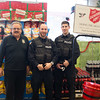 JOED VIERA/STAFF PHOTOGRAPHER-Lockport, NY-Lockport Police Department's Jim Gugliuzza, Matthew Vosler and Anthony Pellittieri work a shift as bell ringers for the Salvation Army's Kettle Drive at Tops.