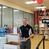 JOED VIERA/STAFF PHOTOGRAPHER-Lockport, NY-  Wireless Zone sales directorTim Steenberg holds a toy can purchase to donate to Toys for Tots at the store.