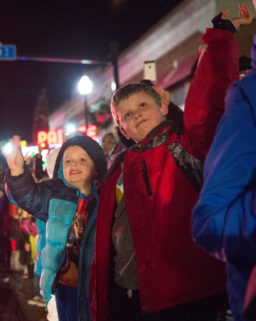 JOED VIERA/STAFF PHOTOGRAPHER-Lockport, NY-   Kids wave at Santa Clauss during the Light Up Lockport Parade in front of the Palace Theatre.