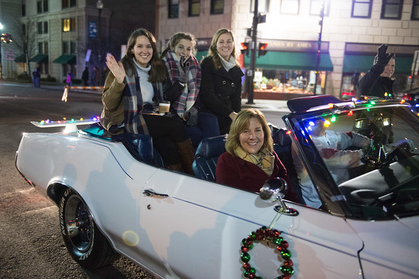 JOED VIERA/STAFF PHOTOGRAPHER-Lockport, NY-   Lockport Mayor Anne McCaffrey rides with her family in the Light Up Lockport Parade.