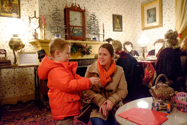 JOED VIERA/STAFF PHOTOGRAPHER-Lockport, NY-   Roger McEachon, 5, and his mother Kelly McEachon make crafts at the Bond House on Thursday night.