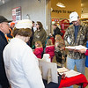 JOED VIERA/STAFF PHOTOGRAPHER-Lockport, NY- Ron and Shirley Weaver look on as Floyd Ferguson purchases a poppy from Terri Emmert during the Poppy Drive at Top's on Transit Road.