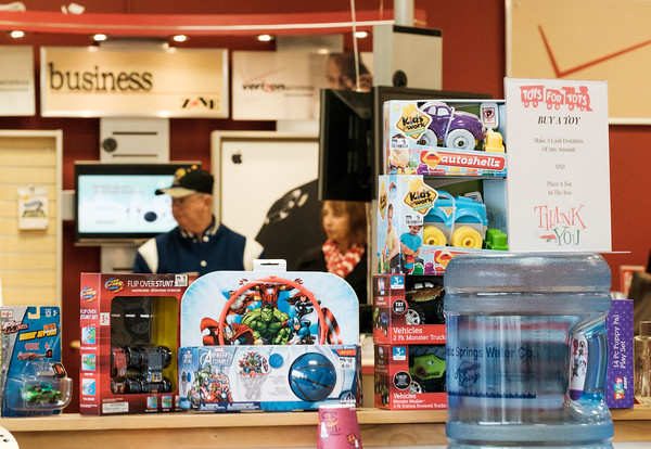 JOED VIERA/STAFF PHOTOGRAPHER-Lockport, NY-  Customers browse Wireless Zone behind a display of toys they can purchase to donate to Toys for Tots at the store.