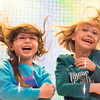 JOED VIERA/STAFF PHOTOGRAPHER- Lockport, NY-Melina Raff, 7, and Mackenzie Landers, 7, laugh as their hair is blown around in Andy Parker's Weather Machine at Roy-Hart Elementary School.