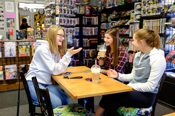 JOED VIERA/STAFF PHOTOGRAPHER-Lockport , NY- Kassidy Calandra, 16, Mikaela Ventura, 15 and Hannah Smith, 16, hang out at Pulp 716 after school.