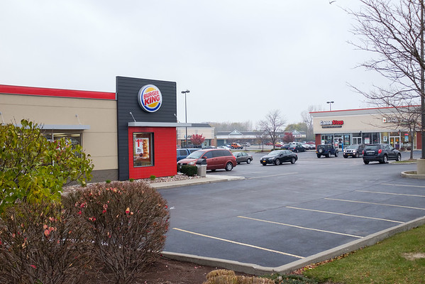JOED VIERA/STAFF PHOTOGRAPHER-Lockport , NY-Businesses in the plaza complain that the addition being proposed will even further obstruct motorists view of their shops from South Transit Road.