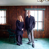 JOED VIERA/STAFF PHOTOGRAPHER-Lockport, NY- Sue Mawhiney and Brian Smith stand in the living room of a foreclosed home in the city's pilot program slated for auction later this month.