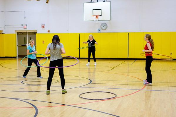 JOED VIERA/STAFF PHOTOGRAPHER-Pendleton, NY-Sally Covey Cindy Daumen,Patti Owczarzak and Jess Najuch hula-hoop at Regan Intermediate School.