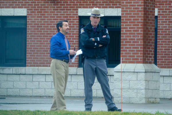 JOED VIERA/STAFF PHOTOGRAPHER-Pendleton, NY-A State Trooper speaks with a school employee outside of Starpoint High School after a lock-out at the school.