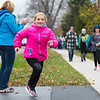 JOED VIERA/STAFF PHOTOGRAPHER-Newfane, NY-Newfane Middleschool student Grace LaRock, 10, passes 6th grade teacher Mary Martin, blue, as she cheers students on during the turkey trot iby the school Wednesday afternoon.