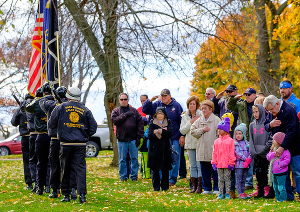 JOED VIERA/STAFF PHOTOGRAPHER-Lockport, NY-  A crowd salutes the Road Runners Color Guard as the retire the colors during the Veterans Day ceremony at Outwater Park.