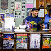 JOED VIERA/STAFF PHOTOGRAPHER-Lockport , NY-Owners Jay and Amy Berent place price tags on action figures at Pulp 716.