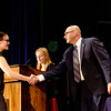 JOED VIERA/STAFF PHOTOGRAPHER-Lockport, NY- Lockport High School sophmore Anna Nilsson, 15,  shakes hands with principal Frank Movalli before receiving her first Academic L during the convocation ceremony inside the  School's auditorium.