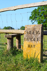 Engraved weathered stone sign for a public bridle way
