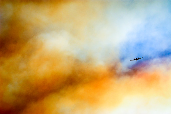 A fire plane pierces the smokey skies above La Grande, OR during the Spring Creek fire, 2005