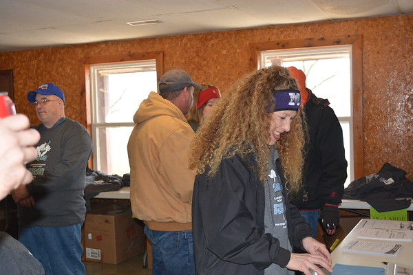 Vanessa Duncan, assistant director of development Special Olympics Illinois Region, helps out during registration at Lake Sara's Polar Plunge.