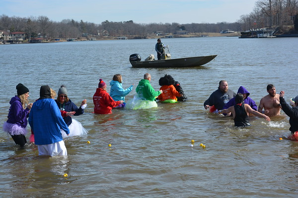 Members of the Olympic Dreamers plunge into Lake Sara for the annual Polar Plunge.
