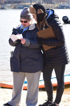 Angie Haarman, a member of the Effingham County Lightning Special Olympics team sings the National Anthem at the start of the Polar Plunge.