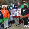 Olympic Dreamers gather at their 10th Polar Plunge at Lake Sara. Shown from left to right are members: Jessica Stoneburner, Mattoon; Heather Trigg, Mattoon; Abbie Pierce, Mattoon; Jennifer Wright, Charleston; Albert Trigg, Charleston; Jason Trigg, Charleston; Ken Thompson, Mattoon; Ashly Thompson, Mattoon; and Marilyn Good, Humboldt.