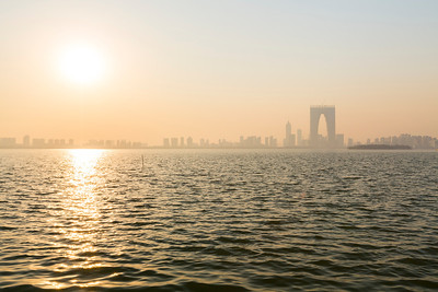 The Gate to the East (东方之门) off in the distance. Jinji Lake (金鸡湖). Suzhou, Jiangsu, China (苏州,江苏,中国)