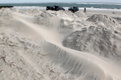 As men surf fish near the ocean, sand blows  on mounds for beach protection in North Wildwood, N.J., Saturday, Oct. 27, 2012, as the area prepares for Hurricane Sandy. From the lowest lying areas of the Jersey shore, where residents were already being encouraged to leave, to the state's northern highlands, where sandbags were being filled and cars moved into parking lots on high ground, New Jersey began preparing in earnest for Hurricane Sandy. (AP Photo/Mel Evans)