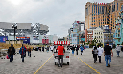 People walk the Atlantic City Boardwalk Saturday Oct. 27 2012 in Atlantic City, N.J.. With Hurricane Sandy taking aim at New Jersey, Gov. Chris Christie ordered Atlantic City's 12 casinos to shut down at 4 p.m. Sunday as part of his statewide emergency declaration. (AP Photo/The Press of Atlantic City, Ben Fogletto) MANDATORY CREDIT