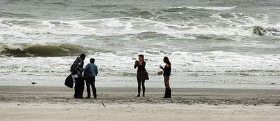 People walk the beach near Bally's Atlantic City in front of a rough ocean, Saturday October 27 2012 in Atlantic City, N.J. With Hurricane Sandy taking aim at New Jersey, Gov. Chris Christie ordered Atlantic City's 12 casinos to shut down at 4 p.m. Sunday as part of his statewide emergency declaration. (AP Photo/The Press of Atlantic City, Ben Fogletto) MANDATORY CREDIT
