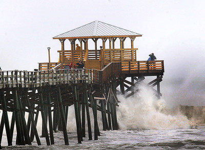 Waves from Hurriane Sandy crash around the pilings at the end of the Oceanana Pier Saturday, Oct. 27, 2012 in Atlantic Beach, N.C.  (AP Photo/The Jacksonville Daily News, Chuck Beckley)