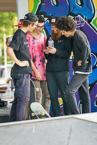 Skateboarders checking mobile