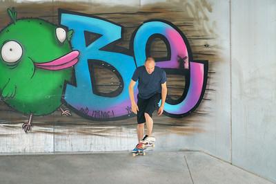 DORDRECHT, NETHERLANDS - 3 SEPTEMBER 2016: Skateboarder begins his run against a wall of grafitti at the official opening of the new skateboard park in Dordrecht.