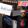 JULIE CROTHERS BEER | THE GOSHEN NEWS<br /> Ty Miller, Elkhart, holds a sign in support of Republican presidential candidate Ted Cruz while rallying Saturday with other supporters in front of the Elkhart County Courthouse.