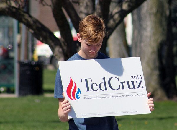 "JULIE CROTHERS BEER | THE GOSHEN NEWS<br /> Oliver Brummel, 19, Elkhart, holds a sign in support of Republican presidential candidate Ted Cruz while standing near the Elkhart County Courthouse Saturday. Brummel said he supports Cruz beause ""he's literally the only person who hasn't lost their mind in the race (for president)."""