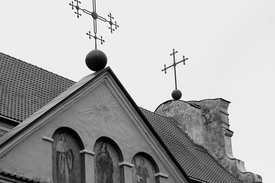 Vilnius, Lithuania -- Vilnius is small & deeply layered;  it is a soft, pastel city accented by an abundance of golden crosses that pierce an ever-gray sky; I only spent a short few days wandering its cobbled complex streets; it strikes me as a place that is broken, semi-repaired, and quietly screaming.