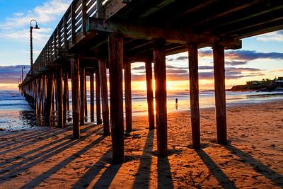 Silhouetted_Pier_Sunset_Beachgoer_DKK3305