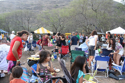 Crowd Enjoying Music, Food, and Raindrops